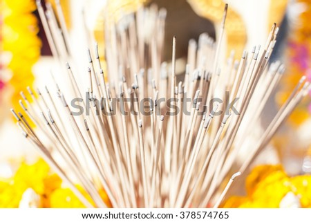 Group of incense on set of altar table