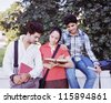Group of Indian / Asian college students discussing  in the campus. - stock photo