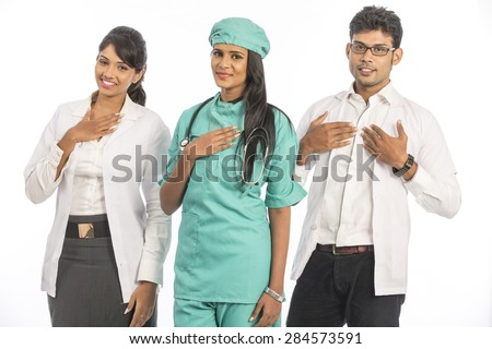 Group of Indian medical doctors, male and female standing isolated on white background. - stock photo