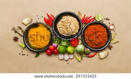 Group of indian spices and herbs on brown background, Top view mix indian spices and herbs difference ware on brown background with copy space for design vegetable, spices, herbs or foods content. - stock photo