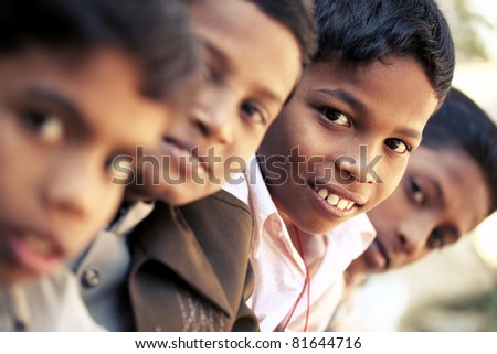 Group of Indian teen boys posing to the camera. - stock photo