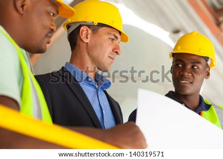 group of industrial manager and workers working on planning - stock photo