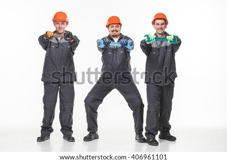Group of industrial workers. Isolated over white background tools - stock photo
