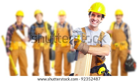 Group of industrial workers with yellow helmet at the construction plant. - stock photo