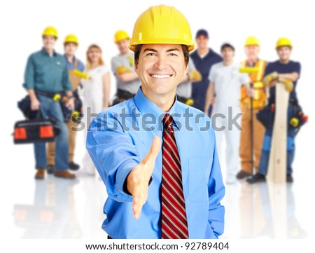 Group of industrial workers with yellow helmet isolated over white background. - stock photo