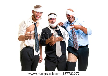 Group of injured businessmen after a game - stock photo