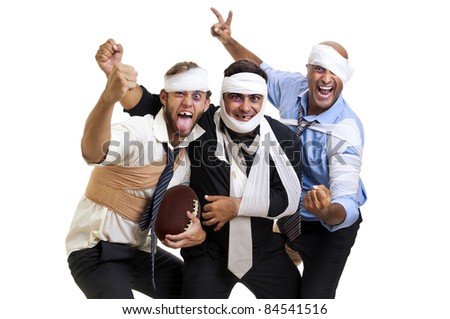 Group of injured businessmen after a rugby game - stock photo
