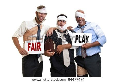 Group of injured businessmen after a rugby game with the words Fair play - stock photo