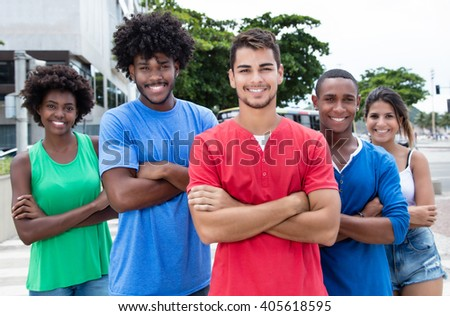 Group of international young adults with standing in city - stock photo