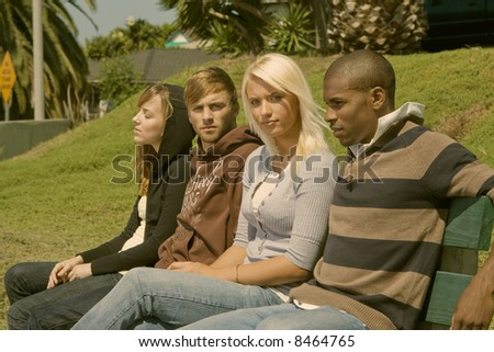 group of interracial friends in the park - stock photo