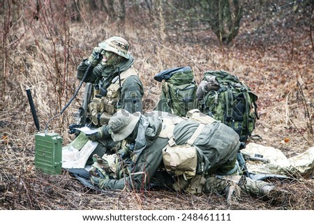 Group of jagdkommando soldiers Austrian special forces evacuating the wounded soldier  - stock photo
