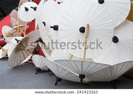 Group of Japanese styled umbrella stacked together - stock photo