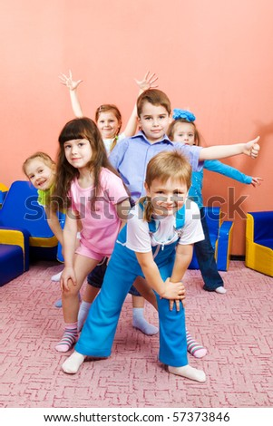 Group of joyful preschool kids - stock photo