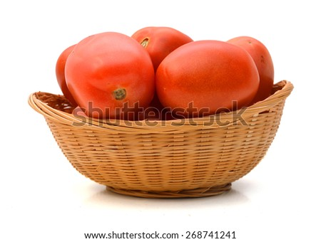 Group of juicy tomatoes in basket on white background  - stock photo