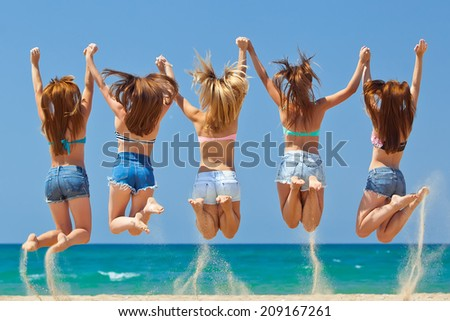 Group of jumping teenager people - stock photo