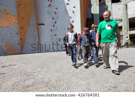Group of Junior athletes led by Coach at opening of Climbing Championship. Dnipro, Ukraine, May 20, 2016 - stock photo