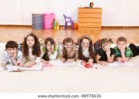 Group of junior students, drawling - stock photo
