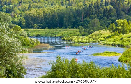 Group of kayakers on Ugra river. Kaluga region, Russia - stock photo
