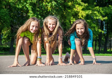 Group of kids at the starting line of a race - stock photo