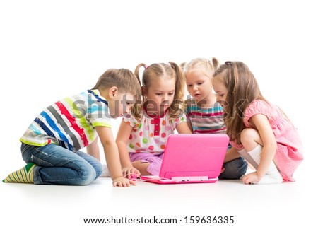 group of kids friends playing at the laptop - stock photo