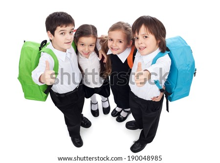 Group of kids holding and giving thumbs up sign - back to school concept, top view - stock photo