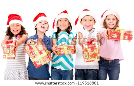 Group of kids holding Christmas presents - isolated over a white background - stock photo