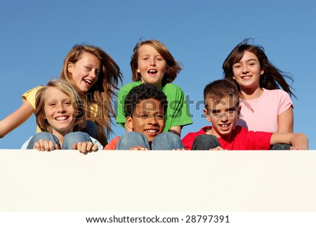 group of kids holding placard with copy space - stock photo