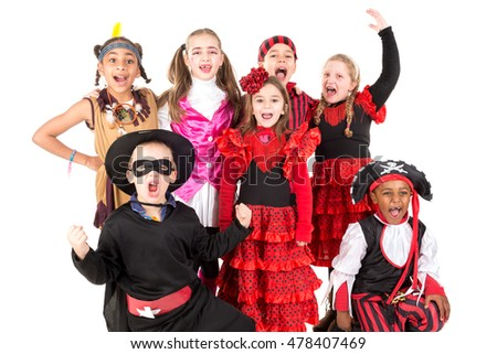 Group of kids in Halloween costumes in a park