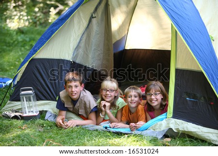 Group of kids in tent - stock photo