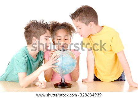group of kids looking at globe at school isolated in white - stock photo