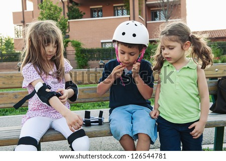 Group of kids outdoor portrait preparing for skating. - stock photo