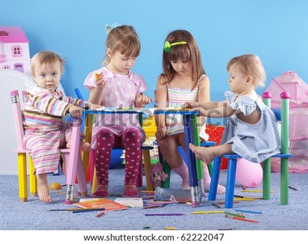 Group of kids playing in the kindergarten - stock photo