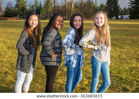 Group of kids standing outside - stock photo