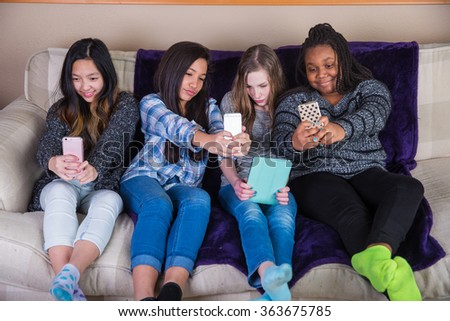 group of kids taking an individual selfie - stock photo