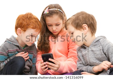 Group of kids using black smartphone. Isolated on white. - stock photo