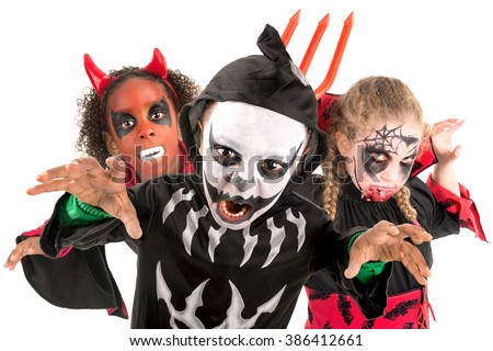 Group of kids with face-paint and Halloween costumes