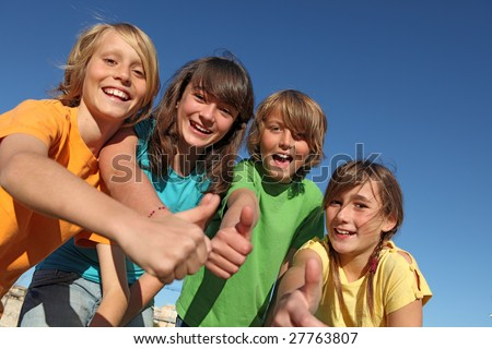 group of kids with thumbs up - stock photo