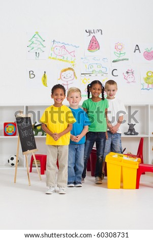 group of kindergarten kids in classroom - stock photo