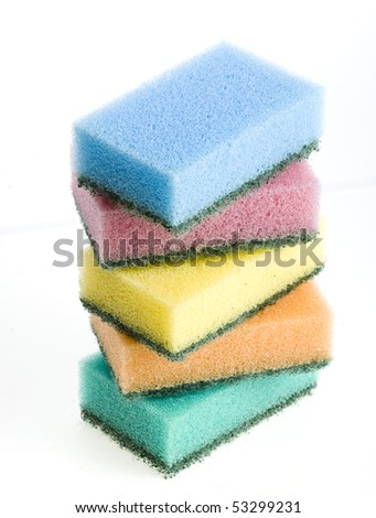 group of kitchen sponges with soapy foam on white background - stock photo