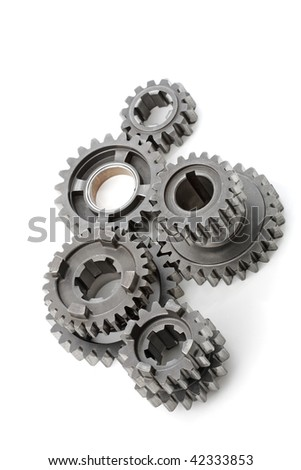 Group of large metal gears on white background. - stock photo