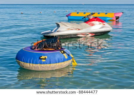 Group of life jackets on life buoy jet ski and banana boat in the - stock photo