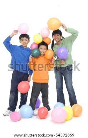 Group Of little asian children with Balloons In Studio