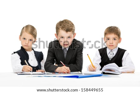 Group of little business people at the table, isolated on white. Concept of teamwork and cooperation - stock photo