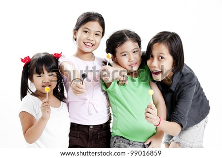 Group of little cute funny asian girl with colorful lollipop candy