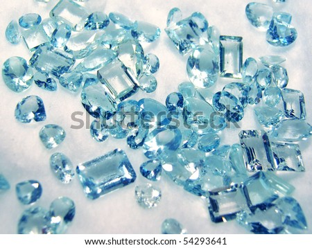 Group of little faceted aquamarines - stock photo