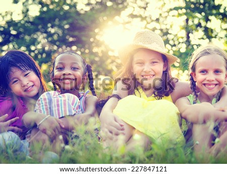 Group of Little Girls Smiling Park Concept - stock photo