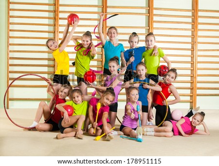 Group of little happy gymnasts - stock photo