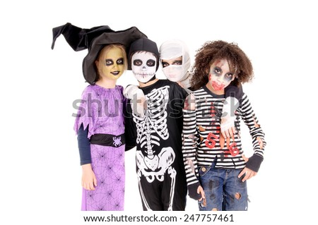 group of little kids with scary costumes on halloween isolated in white - stock photo