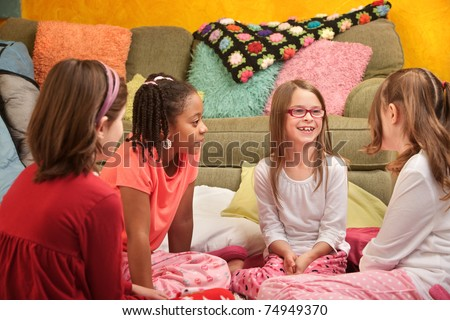 Group of little young girls chat at a sleepover - stock photo