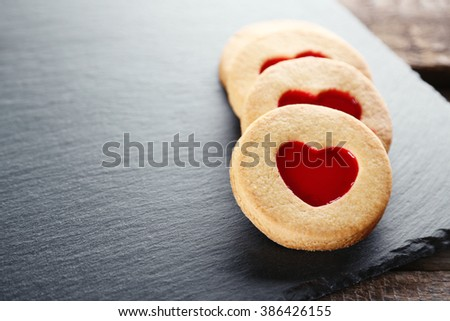 Group of love cookies on grey stand - stock photo